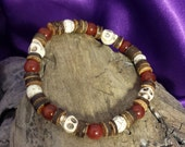 Men's Natural Wooden Heishi Stretch Bracelet with Red Carnelian Round Beads and Howlite Skulls and Round Beads
