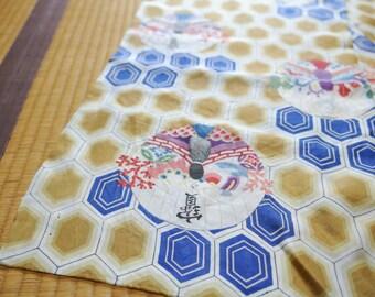 A unique hexagonal pattern kimono silk shawl