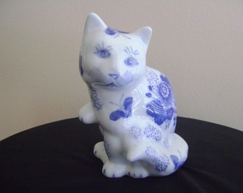 Vintage Blue and White Porcelain Cat Figurine with Blue Flowers and Butterfies