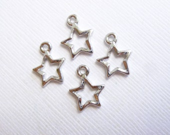Silver Open Star Charms  -- 4 pieces -- Vintage Style Tierracast Pewter Findings