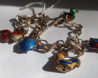 Vintage Enameled Animals in sterling silver Chinese Bracelet includes a rooster,  fish ,a ladybug,a duck and a turtle