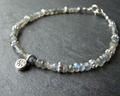 Semiprecious Labradorite bead bracelet with tiny thai silver spacer beads and a flower charm