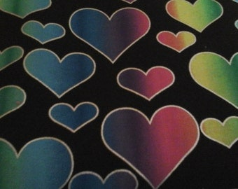 scrub top  with black background and hearts