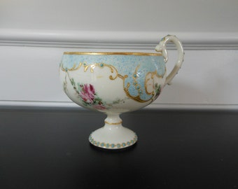 Exquisitely decorated tall stem teacup, c. 1920s