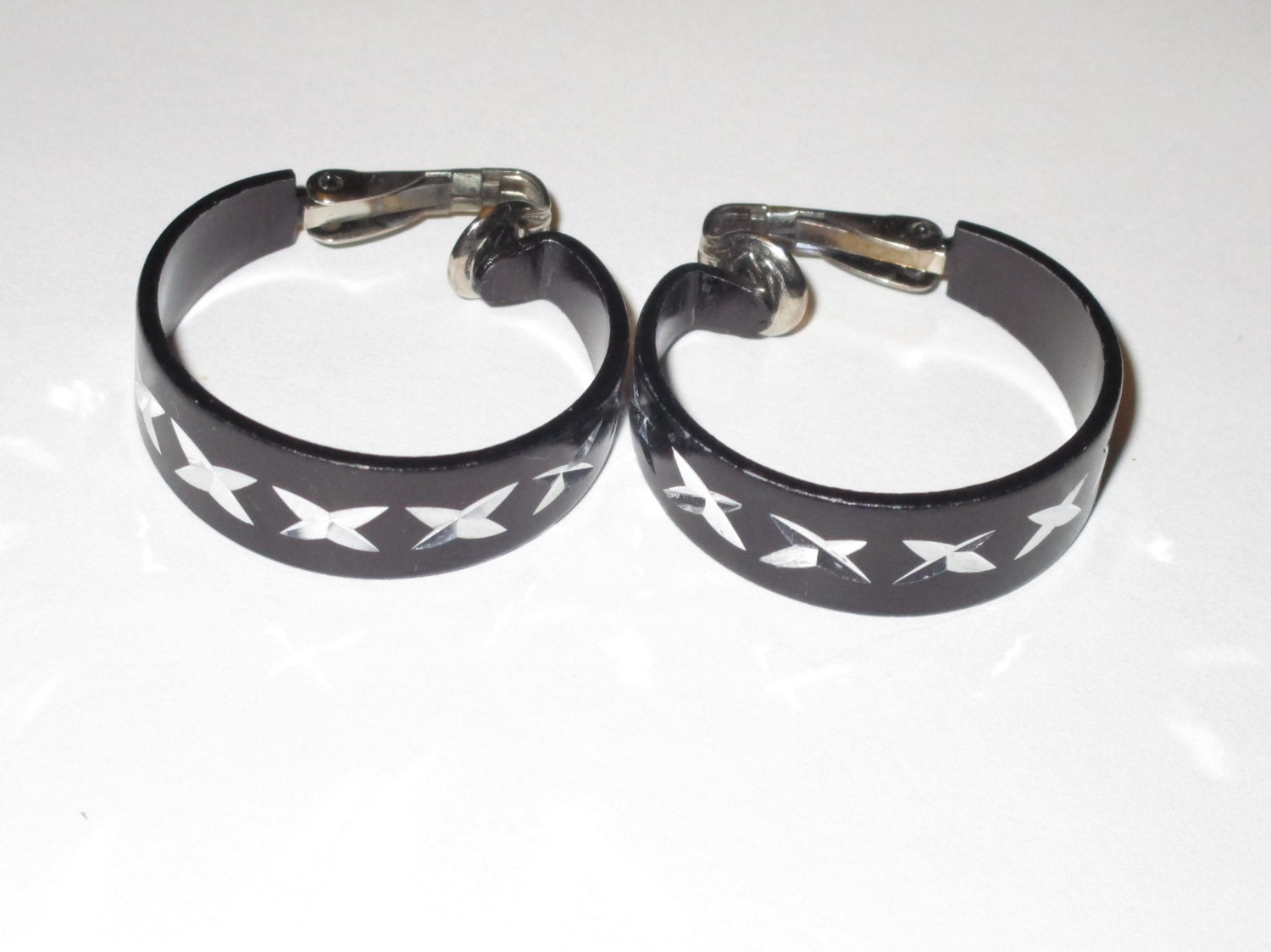 black clip on earrings marked hong kong epsteam