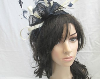 Stunning Navy Blue with ivory  trim  Sinamay  rosette and  Feather Fascinator...crystal stamen