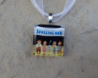 Broadway Musical The 25th Annual Putnam County Spelling Bee Glass Pendant and Ribbon Necklace