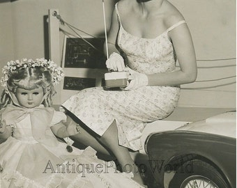 Woman with radio controlled doll vintage toy photo