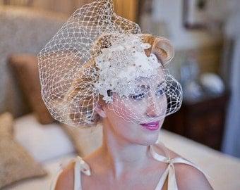 Zara. Vintage headpiece with a flourish of birdcage veiling on a comb.