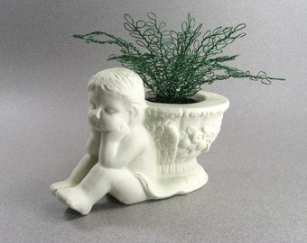 Charming Cherub with green wire plant