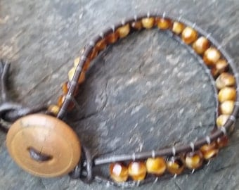 "8"" Light Amber Swirl Faceted Glass Bead Leather Bracelet"