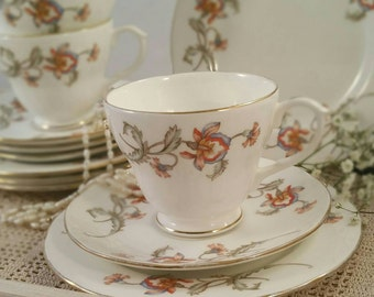 Vintage Duchess Tea cup, saucer and side plate trio with floral pattern and gold gilding.