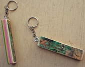 Keychains handcrafted from a recycled skateboard decks