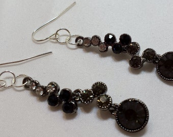 Black and white dangle earrings.