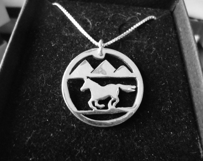 Horse w/mountains necklace quarter size w/sterling silver chain