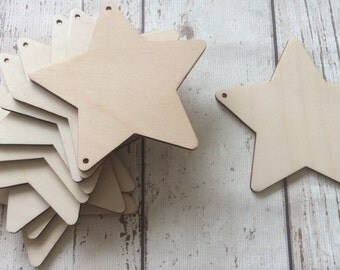 pack of 10 unpainted laser cut stars with two holes perfect for garland or bunting
