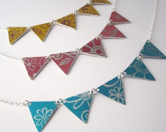 Floral patterned anodised aluminium bunting necklace