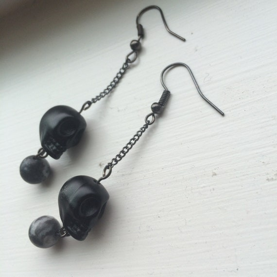 black skull dangle earrings with black and white by