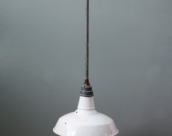 A quirky white industrial light
