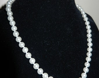 "Two White Pearl Necklaces - 17"" long and 15"" long"