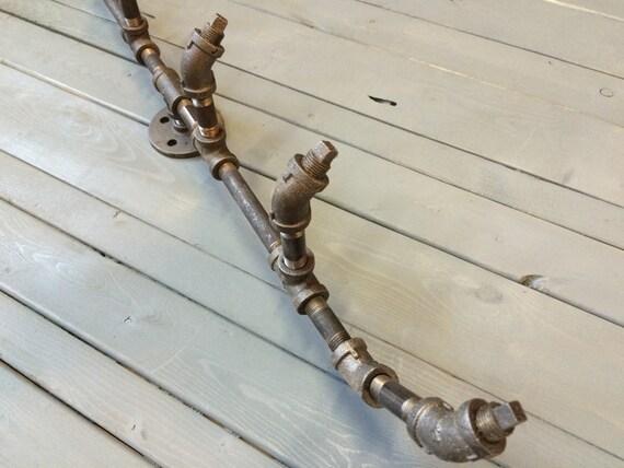 Coat peg rack octopus pipewerks hooks pegs by pipewerks on etsy - Octopus coat hook ...