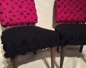 The Flora mid-century chairs in black and fuchsia with petal details