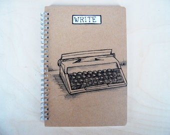 Notebook WRITE with typewriter drawing