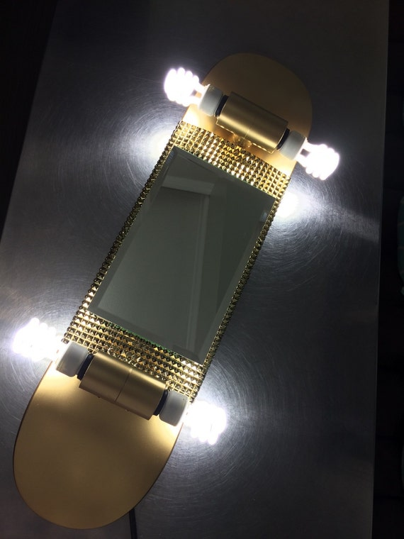 Vanity Lights Gold : All gold skateboard vanity light.