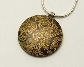 Mokume Gane Pendant - stamp-patterned organic lines and dots in brass and copper