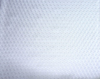 "Lacey White Sheer Stretch Fabric.  60"" wide and sold by the yard"