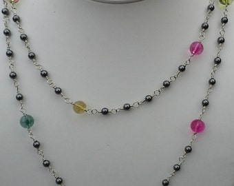 Handmade silver, hematite, and colors and round tourmaline beads