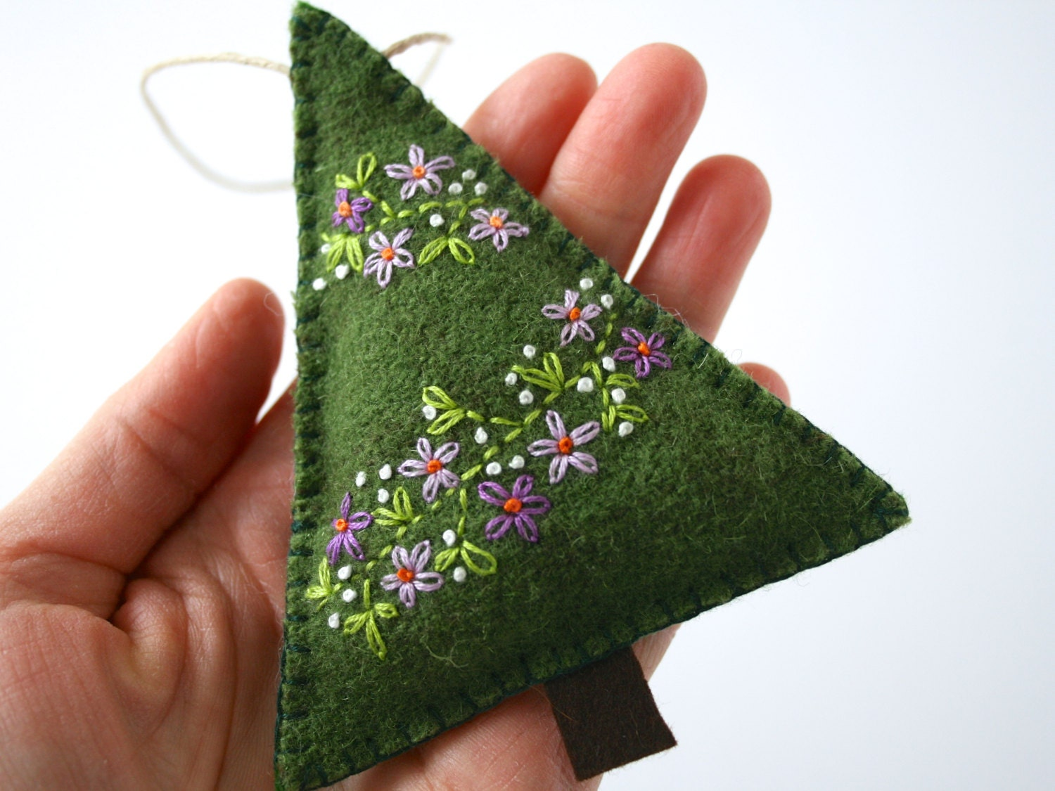 woodland wool felt christmas tree ornament with a hand