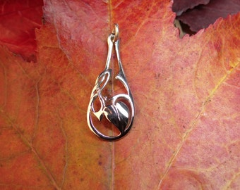 small sterling silver pendant,34mm long, 1.26grms weight. Heart shaped leaf and celtic knot motif