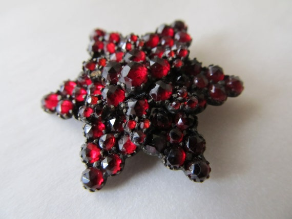1910 Garnets Make this Star brooch a great gift from RetroRoadshow on etsy