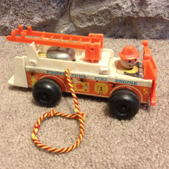 vintage fisher price fire truck pull toy with by retrotoysandmore. Black Bedroom Furniture Sets. Home Design Ideas