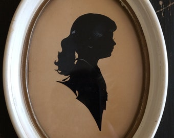 Vintage Silhouette of a Young Girl