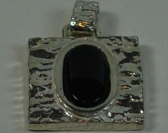 Silver pendant onyx textures.
