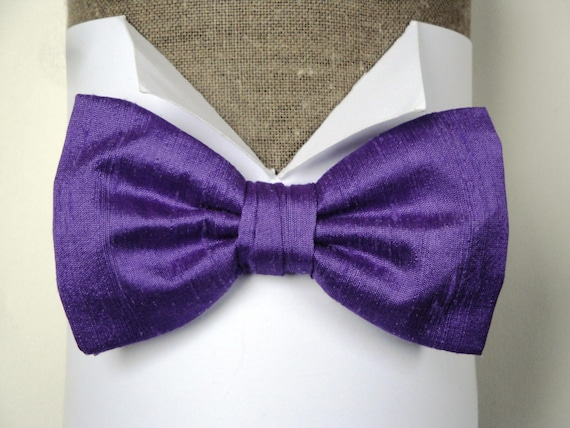 "Purple Silk Bow Tie, Pre tied or self tie on an adjustable band, will fit neck size up to 19.5"" (48cms)"