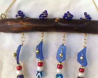 Sea Glass Windchime Exclusive Design Dark Blue with Ladybugs and Swirled Wire Accents from Crafts by the Sea