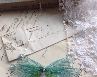 Pretty blue rainbow Faerie wing s small Necklace