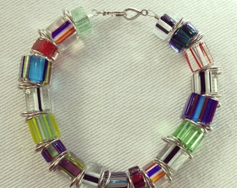 Cane glass bead bracelet with sterling silver jump rings and clasp.