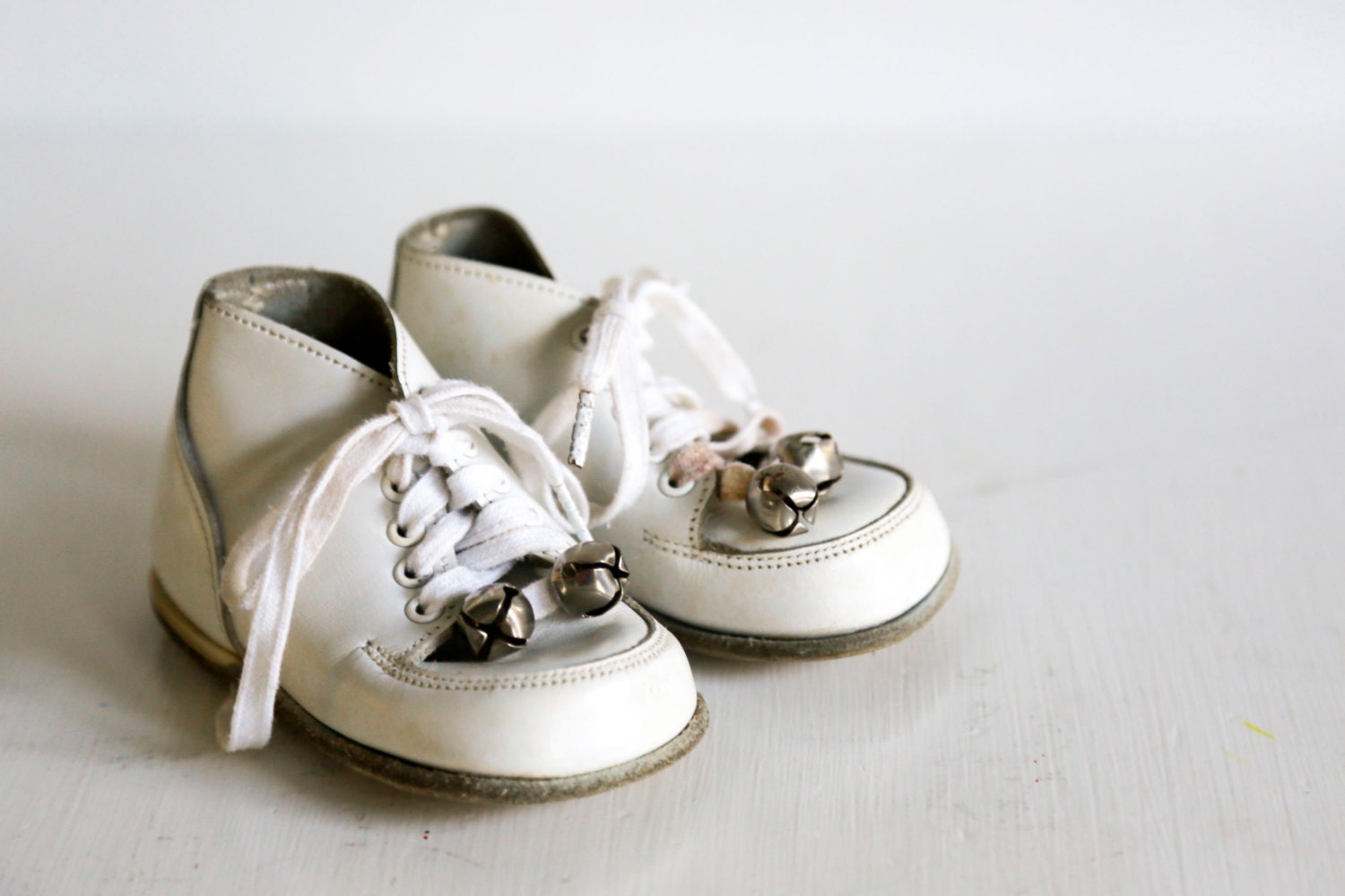 vintage white leather baby shoes with bells lace up by