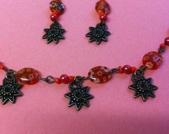 Red flower bead necklace and earrings with copper star charms