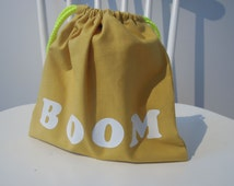 Sale - price as marked. Handmade drawstring bag. Mustard cotton fabric with iron on letters.