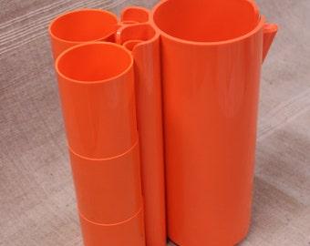 Make us an offer! Plastic beverage set, 6 cups and jug, vintage French
