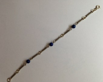 Great little vintage sterling silver bracelet with lapis ball detail