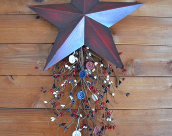 Rustic red metal star wall hanging with red, white, and blue pip berries and buttons.