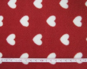 Polar fleece Red with polka dot style hearts per metre - FREE shipping