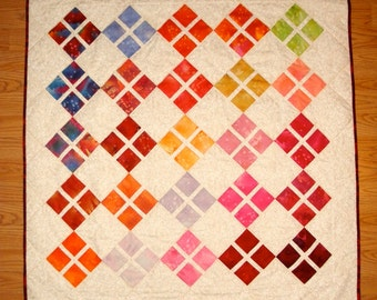 bright colored  baby girl quilt