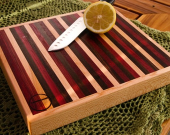 Colorful and Vibrant Wood Cutting Board, or serving board, in a Bright Striped Pattern